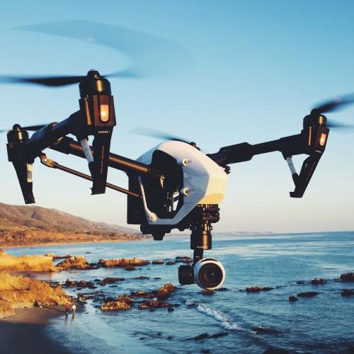 DJI Inspire 1 in flight over the ocean